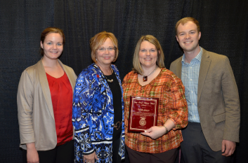 Donelle Johnson (middle right), recipient of the 2013 Gary Scharf Helping Hand Award, is pictured with members of Gary Scharf's family.