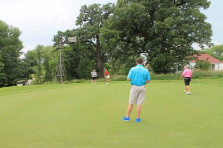 Golfers participated in a putting contest.