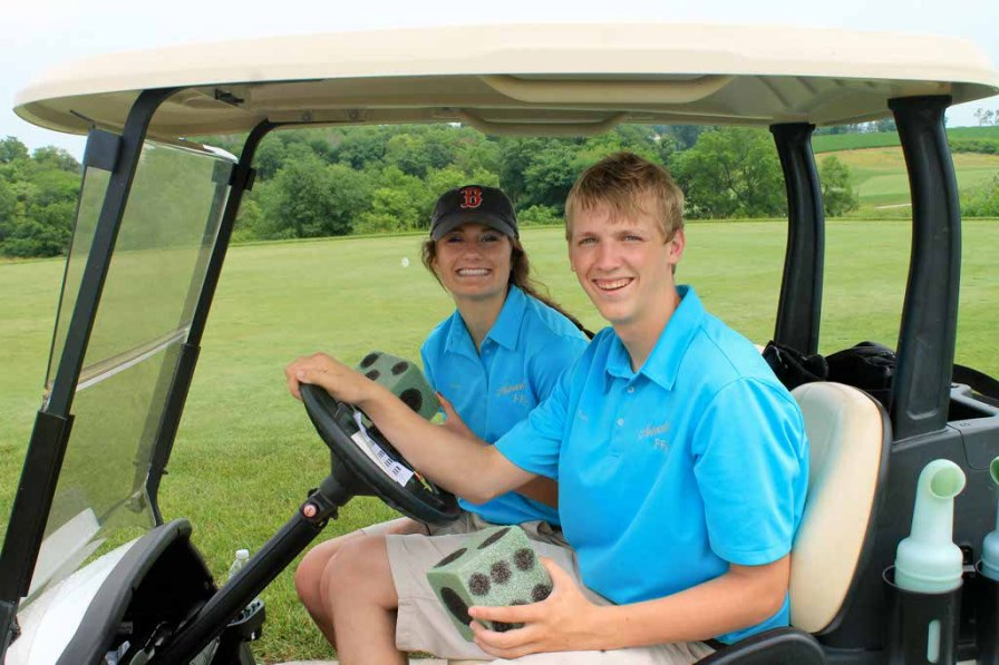 Morgan Kowalewski and Trey Mogensen, both Nebraska FFA State Vice Presidents, pose with the dice for the Roll the Die hole.